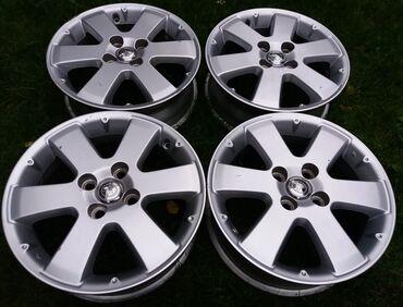 Оригинальные R15 диски Toyota IST (4*100)Диски б\у в отличном