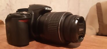 Nikon d3100 . Heç bir problemi yoxdu. Hd video'da çekir. Üstündə