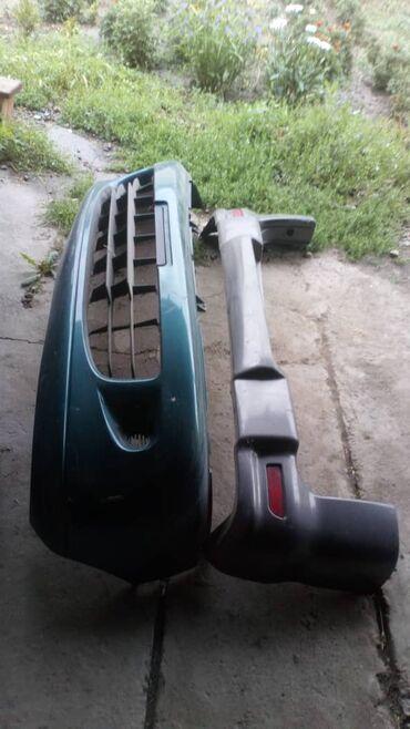 Продам передний и задний бампер от Митсубиси Делика состояние отличное