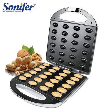 127 объявлений | ЭЛЕКТРОНИКА: Орешница Sonifer 24 порции. Изготовлена орешница из прочного пластика