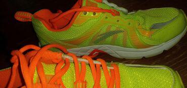 Фабричный качественный.беговые кроссовки. Покупали в Москве