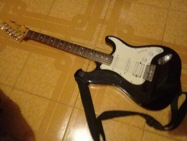 gitara satilir в Азербайджан: Elektro gitara satilir yeni kimidir.Super. K E L V I N. Firmasi