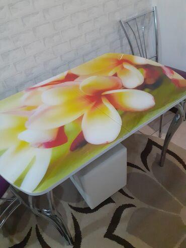 В связи отъездом продаю стеклянный раздвижные стол красивая