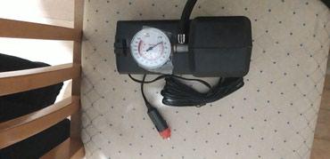 Ostalo | Mladenovac: Auto-kompresor koji radi na auto-upaljač.Nov,nekorišcen sa dodacima za