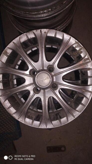 диски титановые в Кыргызстан: Продаю титановый диск комплект (4шт) фирма SKAD (Россия) 14размер