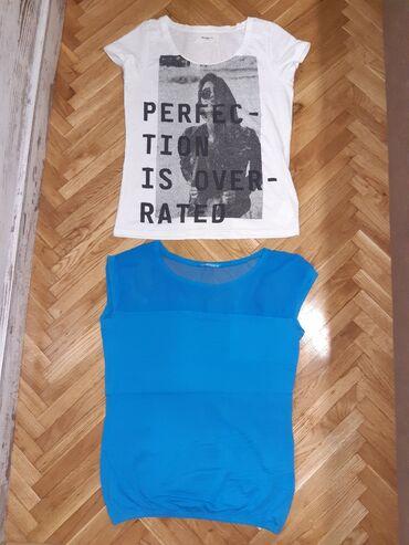 Dve majice vel.M u dobrom stanju. Plava je pamucna a gore je til. Obe