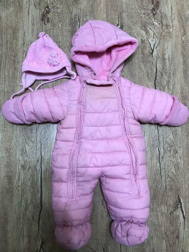 Продаю 2 детских комбинезоны б/у (розовый с зимней шапочкой для детей