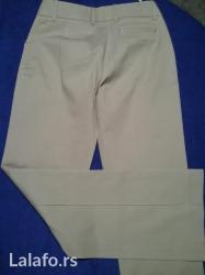 Klasicne pantalone  sa vidljivom prostepanom ivicom sa prednje strane in Novi Sad