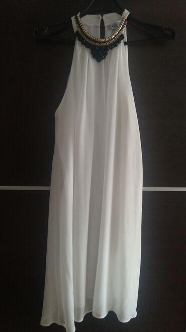 Bela haljina, jednom obučena, do kolena, L veličina. Cena 800 dinara