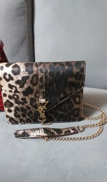 1161 объявлений | СУМКИ: Продаю тигровую сумку Yves Saint Laurent с длинным ремешком(цепи) б/у