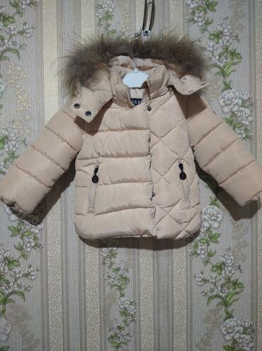 Продаю курточку очень теплую натуральный варотник фирменная почти нова