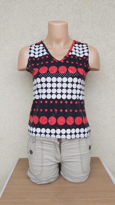 Zanimljiva bluza kao novaPoliester/elastinDuzina 49cmGrudi