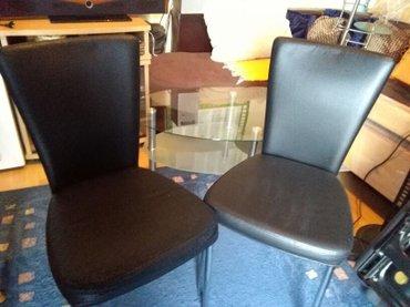 stolice dve crne,kao kopija koze,jedna malo koristena,a druga kao nova - Sombor