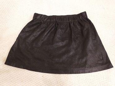 Zenski-tricetvrt - Srbija: Beba Kids crna suknjica za devojčce, veličina 10. Vise odgovara 8 ili