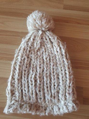 Zimska kapa UniverzalnaLastiš koji je na dnu se moze skinuti pa je