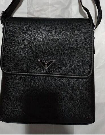 - Azərbaycan: Kişi çantası