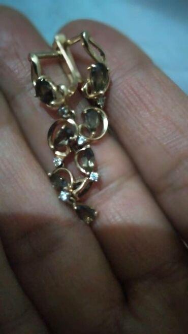 Золото Российский,пр585.гр 3,92.длина 4,см.14.0000.камень коречневый