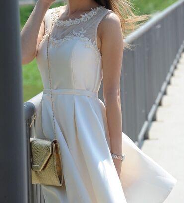 Elegantna haljina, od predivnog materijala, obucena samo jednom, kao