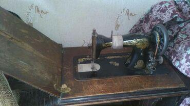 старинную монету в Кыргызстан: Швейная старинная машинка Singerможно использовать для шитья толстой