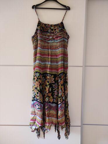 3988 oglasa: Duga haljina velicina 44. Odgovara za XL. Fali ruckica na snjiru