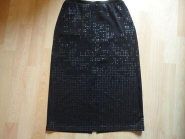 Uska suknja velicine od S-M. u perfektnom stanju. Od dosta