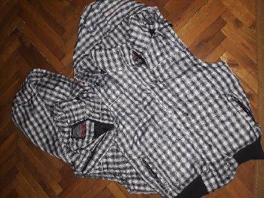 Prsluci   Srbija: Dva ženska prsluka, jedan u XL veličini, a drugi XXLoba prsluka za