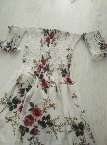 Duga cvetna haljina, napred kraca, prikazano na slici kako je secena