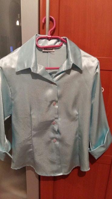 Košulja svetlo-plave boje,pise univerzalna vel.ali to je francuski - Petrovac na Mlavi