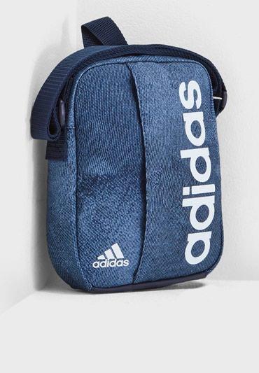 Сумка адидасЭта сумочка на плечо оправдает ваши ожидания. Основное