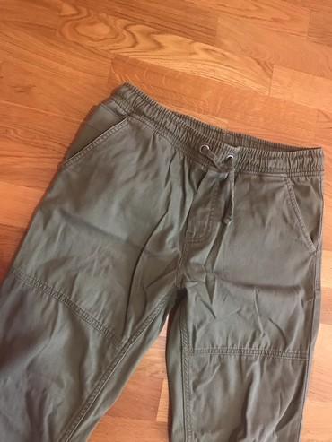 Pantalone boja maslinasto zelena kvalitetne super meka - Srbija: Pantalone za S velicinu cena 900 din maslinasto zelena boja