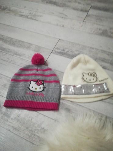 Zenske kape obim cm - Srbija: Kape Hello Kitty velicina 54 cm. Orginalne. Vredi uzeti. Obe 600 din