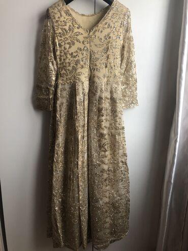трикотажное платье без рукавов в Кыргызстан: Продаю шикарное золотистое платье! Одевала 2 раза. Размер 44. Матери