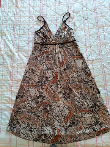 Nova letnja haljina tanka lepo pada niz telo, velicine L/XL. Nije