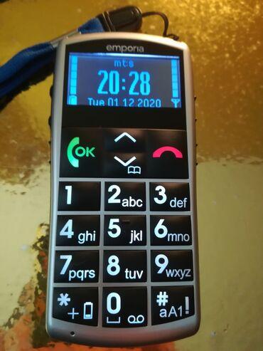 Emporia telefon kao nov. Baterija nova, radi na sve mreze uz njega