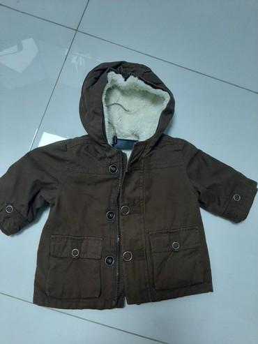 Nova jakna za bebe,krzno sw skida. za 9 meseci - Pancevo