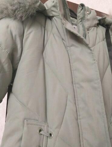 Продаётся :Теплая зимняя куртка .Ростовска 150 см на девочку - 9, 10
