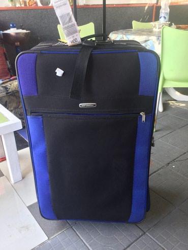 Sport i hobi - Sopot: Putna torba sa rucicom i tockicima dimenzije 90x50x30 jednom koriscena