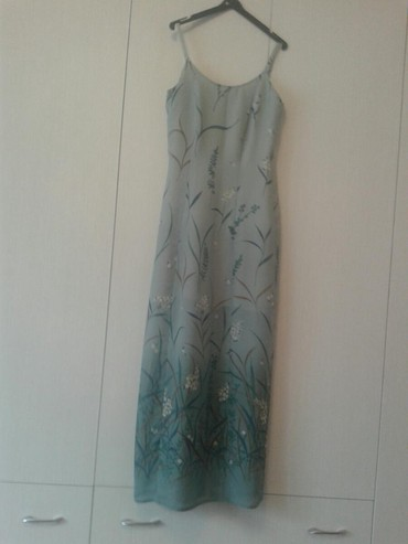 Sivena maksi haljina,odgovara broju 38 -40.postavljena materijalom ne - Valjevo