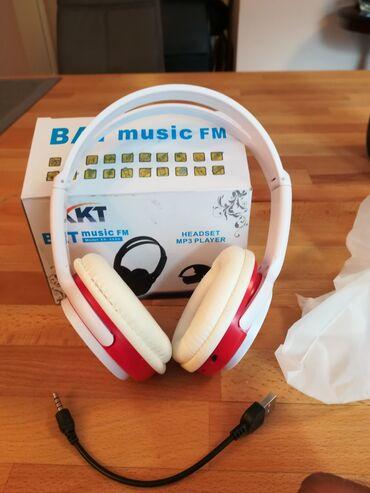 Slušalice novoo. FM. MP3 . 900 din