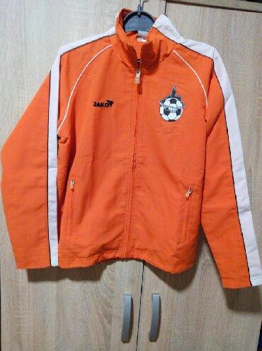 Dečije jakne i kaputi | Arandjelovac: Sportska jakna, tanja, za uzrast od 12 godina. Jakna je očuvana