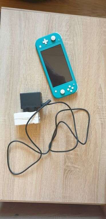 Nintendo Switch - Azərbaycan: Nintendo Switch Lite +256gb memory card (yaddaş kartı)+ 3 oyun İdeal