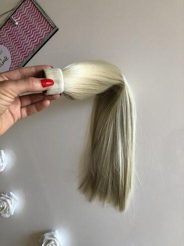 Peglanje vesa - Srbija: Platinasto plavi rep od vestacke kose. Odlicno se ponasa. Ne sija
