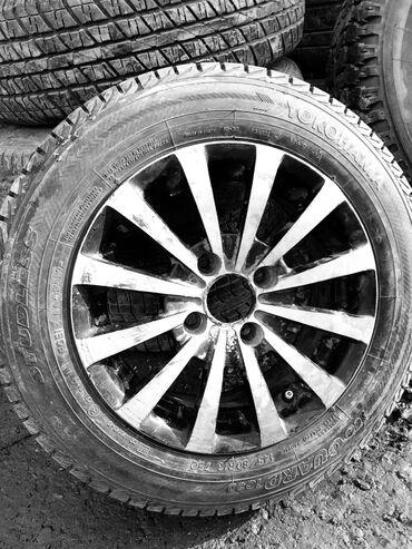 Диск литой под 13 радиус 1500 сом, с шиной в сборе 2500 сом