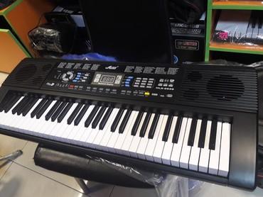 Sintizator 5 oktavali flaskartli mikrafonlu piano dersine gedenler