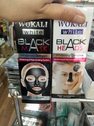 Bakı şəhərində Agardıcı ve derini temizleyen qara maskalar.