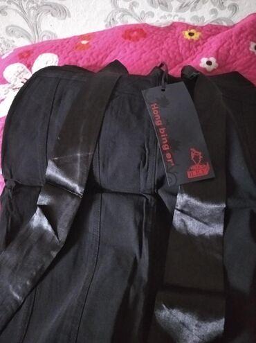 Продаются юбки женские дешево. Школьникам детям юбки черный свет