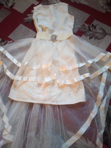 туника бежевая в Кыргызстан: Платья 400сом одивала один раз цвет бежевый