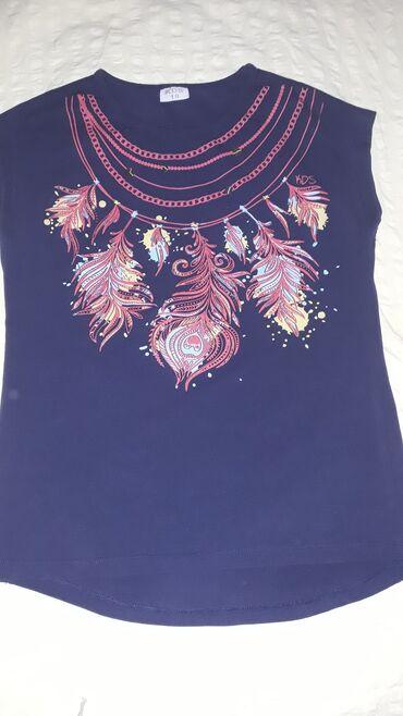 Dečija odeća i obuća - Sombor: Majice za devojcice 8-10 paketMajice su ocuvane nema