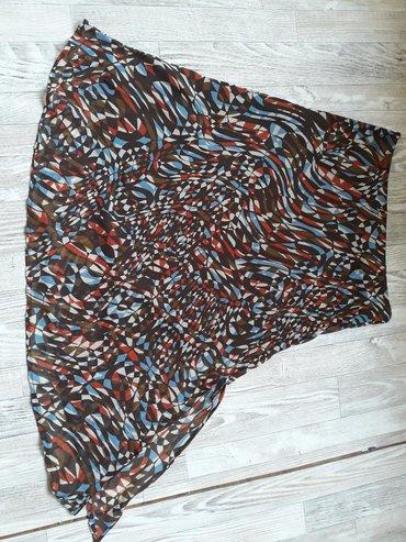 Asimetricna postavljena suknja,100% poliester,poluobum struka