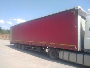 Транспорт - Кызыл-Адыр: Продаю прицеп Schmitz (105куб) кубовик 2004год, покрышки кругом новый